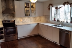 AFTER: Completely remodeled with new IKEA cabinets, SS appliances, quartz counters, and marble back splash.